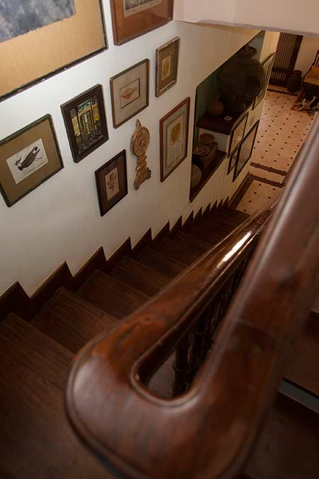 Collection of Art Lining the Staircase at Rockheart